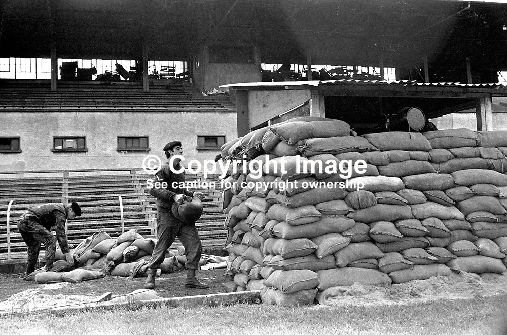 British soldiers erect an observation post on the playing pitch at Casement Park, Belfast, N Ireland. Casement Park is the principal stadium for gaelic games in the city. Traditionally the GAA is staunchly republican and the army's decision to locate an observation post in Casement Park would have been considered provocative. 197208030431.<br /> <br /> Copyright Image from Victor Patterson, Belfast, UK<br /> <br /> t: +44 28 9066 1296 (from Rep of Ireland 048 9066 1296)<br /> m: +44 7802 353836<br /> e: victorpattersonbelfast@gmail.com<br /> <br /> www.images4media.com<br /> <br /> Please see my full Terms and Conditions of Use at https://www.images4media.com/p/terms-conditions - it is IMPORTANT that you familiarise yourself with them.<br /> <br /> Images used online incur an additional cost. This cost should be agreed in writing in advance. Online images must be visibly watermarked i.e. © Victor Patterson or that of the named photographer within the body of the image. The original metadata must not be deleted from images used online.<br /> <br /> This image is only available for the use of the download recipient i.e. television station, newspaper, magazine, book publisher, etc, and must not be passed on to a third party. It is also downloaded on condition that each and every usage is notified within 7 days to victorpattersonbelfast@gmail.com.<br /> <br /> The right of Victor Patterson (or the named photographer) to be identified as the author is asserted in accordance with The Copyright Designs And Patents Act (1988). All moral rights are asserted.