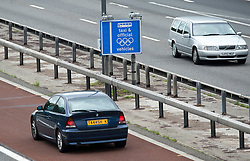 © London News Pictures. 16/07/2012. London, UK. A normal commuter vehicle vehicle travelling on the M4 Olympic lane on July 16, 2012 which opened today. Journeys for Olympic officials and athletes into central London are intended to be eased by the Olympic lane on the M4 motorway, which is the main route in to central London from Heathrow airport. Photo credit: Ben Cawthra/LNP.