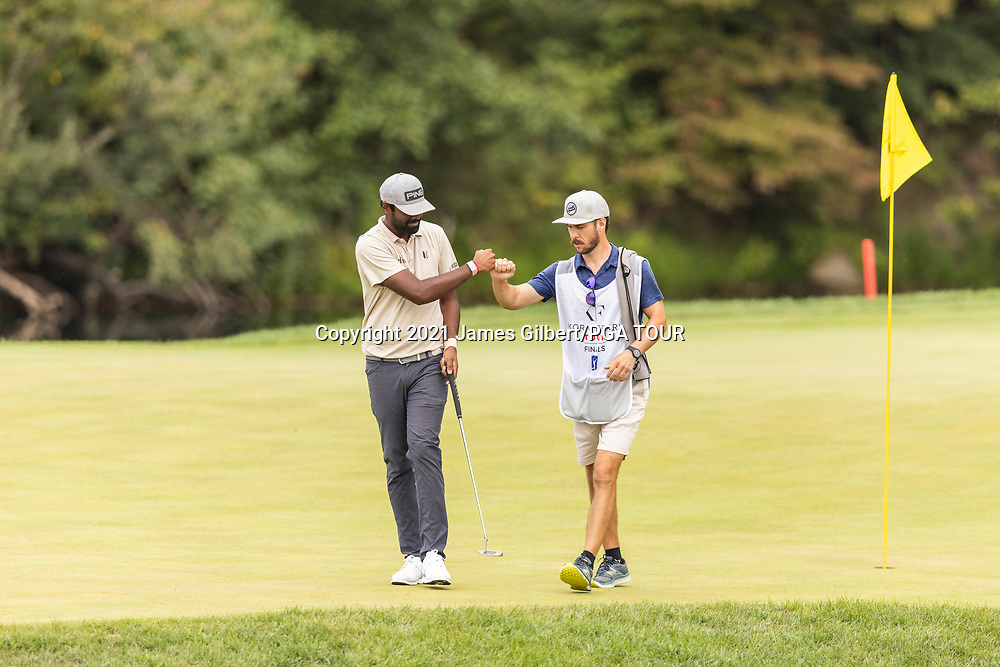 NEWBURGH, IN - SEPTEMBER 04: Sahith Theegala fist bumps his caddie on the 16th green during the third round of the Korn Ferry Tour Championship presented by United Leasing and Financing at Victoria National Golf Club on September 4, 2021 in Newburgh, Indiana. (Photo by James Gilbert/PGA TOUR via Getty Images)