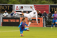 Cove Rangers' Connor Scully (4) Inverness Caledonian Thistle's Roddy MacGregor (12) battles for possession, tussles, tackles, challenges, during the Premier Sports Scottish League Cup match between Cove Rangers and Inverness CT at Balmoral Stadium, Aberdeen, Scotland on 20 July 2021.