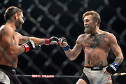 Conor McGregor taunts Chad Mendes during UFC 189 at the MGM Grand Garden Arena in Las Vegas, Nevada on July 11, 2015. (Cooper Neill)