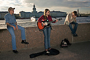 Saint Petersburg, Russia, 23/07/2005..Buskers, foreign tourists and Russians on Palace Quay by the River Neva.