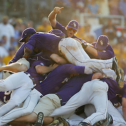 06 June 2009:  Players dogpile on LSU pitcher Matty Ott following the final out during a 5-3 victory by the LSU Tigers over the Rice Owls in game two of the NCAA baseball College World Series, Super Regional played at Alex Box Stadium in Baton Rouge, Louisiana. The Tigers with the win advance to next week's College Baseball World Series in Omaha, Nebraska.