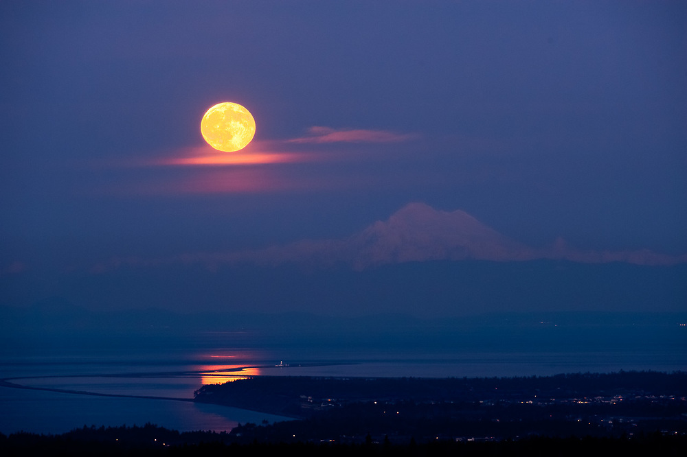 Full moon over the Dungeness Spit, Salish Sea, Mount Baker in the distance, Washingtion, USA