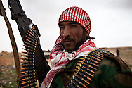 A rebel army volunteer perpare to fight forces loyal to Qadaffi in a town near Ras Lanuf  on March 3, 2011.