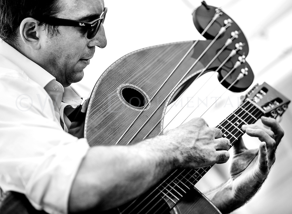 Andrew Kasab, folk guitarist based out of Raleigh, plays the Txakolifest on May 16, which was hosted at Six Plates, Durham, focusing on culture, food and wine from the Basque Region of Spain. Kasab strummed the harp guitar, pictured here, playing various folk songs in harmonic guitar arrangements.