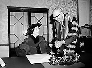 Joan Denise Moriarty, founder of professional ballet in Ireland, receives an Honorary Degree from University College Cork, at Iveagh House. Dr T.K. Whitaker, Chancellor of the National University of Ireland, holds the pen with which she signed the acceptance scroll.<br /> 05/04/1979