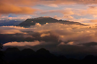 Himalayan peaks above the Pokhara Valley peer out on a foggy morning, Nepal.