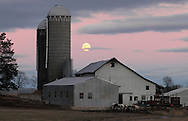 Town of Wallkill, New York  - The full moon rises behind the barn and silo at Crestview Dairy Farm on Jan. 8, 2011.