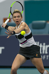 March 25, 2019 - Miami Gardens, FL, USA - Simona Halep, of Romania, returns a shot to Venus Williams, of the United States, during their match at the Miami Open tennis tournament on Monday, March 25, 2019 at Hard Rock Stadium in Miami Gardens, Fla. (Credit Image: © Matias J. Ocner/Miami Herald/TNS via ZUMA Wire)