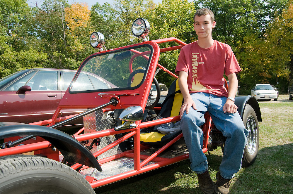 Peter Lee age 16 from St. Peter's parish in Slinger, Wisconsin sits by his car in the parking lot at the St. John Bosco Youth Rally on September 27, 2008 at Holy Hill in Hubertus, Wisconsin. Peter has worked on his for four years before being able to drive it this year. He is attending as part of confirmation preparation.