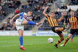 Birmingham City's Che Adams (left) shoots towards goal