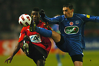 FOOTBALL - FRENCH CUP 2010/2011 - 1/8 FINAL - STADE RENNAIS v STADE DE REIMS - 1/02/2011 - PHOTO PASCAL ALLEE / DPPI - JULIEN TOUDIC (REIMS) / ALEXANDER TETTEY (RENNES)