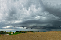 A severe thunderstorm approaches the farmland near Edgington, Illinois. This storm brought strong winds, large hail, and frequent lightning as it marched across Iowa and crossed the Mississippi River a few miles away.<br />
