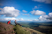 © Licensed to London News Pictures. 15/10/2016. Brecon Beacons, UK A man takes a moment between showers to take a picture of the view. Clouds over walkers in showery and bright weather on Fan Y Big in the `Brecon Beacons National Park. Photo credit : Stephen Simpson/LNP