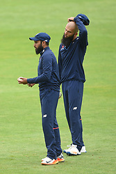 England's Adil Rashid (left) and Moeen Ali during the nets session at Cardiff Wales Stadium.