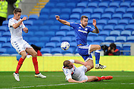 Wigan' Athletic's Jake Buxton (on floor) blocks Cardiff city's Joe Ralls shot. EFL Skybet championship match, Cardiff city v Wigan Athletic at the Cardiff city stadium in Cardiff, South Wales on Saturday 29th October 2016.<br /> pic by Carl Robertson, Andrew Orchard sports photography.