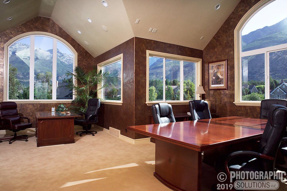A home office with a view of the nearby mountains