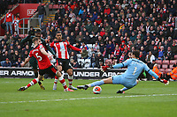 Football - 2019 / 2020 Premier League - Southampton vs. Newcastle United<br /> <br /> Allan Saint-Maximin of Newcastle slots the ball past Southampton's Alex McCarthy to put Newcastle into the lead at St Mary's Stadium Southampton<br /> <br /> COLORSPORT/SHAUN BOGGUST