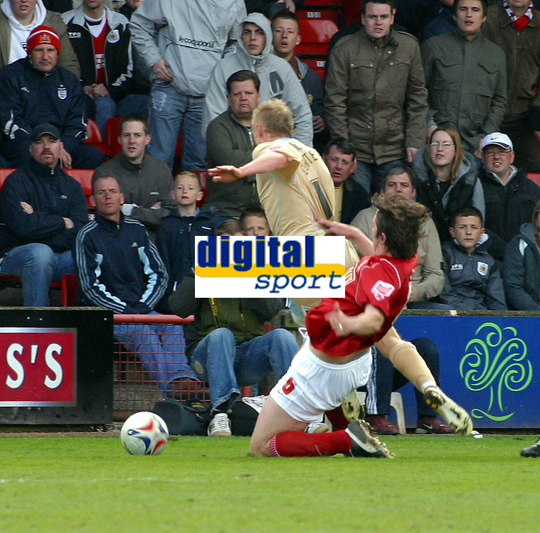 Photo: Dave Linney.<br />Walsall v Bristol City. Coca Cola League 1. 08/04/2006.<br />Bristol's Dave Cotterill is brought down by  Ian Roper to give away a penalty