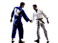 two judokas fighters fighting men handshake in silhouette on white background