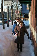 Brookline, MA 02/10/2013<br /> Kathy and George Scott of Brookline negotiate a tight, snow-filled sidewalk on Harvard Ave. on Sunday afternoon.
