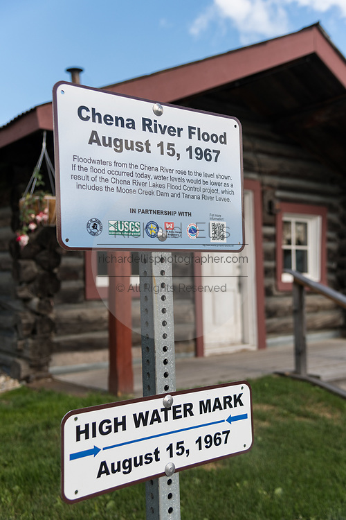 Marker in front of the Gould Cabin showing the high water mark from the 1967 Chena River flood Griffin Park in downtown Fairbanks, Alaska.