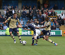 Leeds United's Rodolph Austin brings down Millwall's Scott Malone but no penalty given - Photo mandatory by-line: Robin White/JMP - Tel: Mobile: 07966 386802 28/09/2013 - SPORT - FOOTBALL - The Den - Millwall - Millwall V Leeds United - Sky Bet Championship