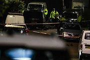 Police guard a crime scene entry by the Dale Close Road, in Barnet, North London on late Wednesday, Sept 23, 2020, after several police officers have been injured by a chemical substance while carrying out a drugs raid in north London. (VXP Photo/ Vudi Xhymshiti)