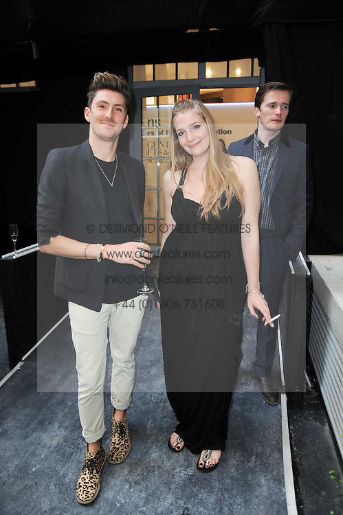 Designer HENRY HOLLAND and HELENA REA at a dinner hosted by Harper's Bazaar to celebrate Browns 40th Anniversary in aid of Women International held at The Regent Penthouses & Lofts, 16-18 Marshall Street, London on 20th May 2010.