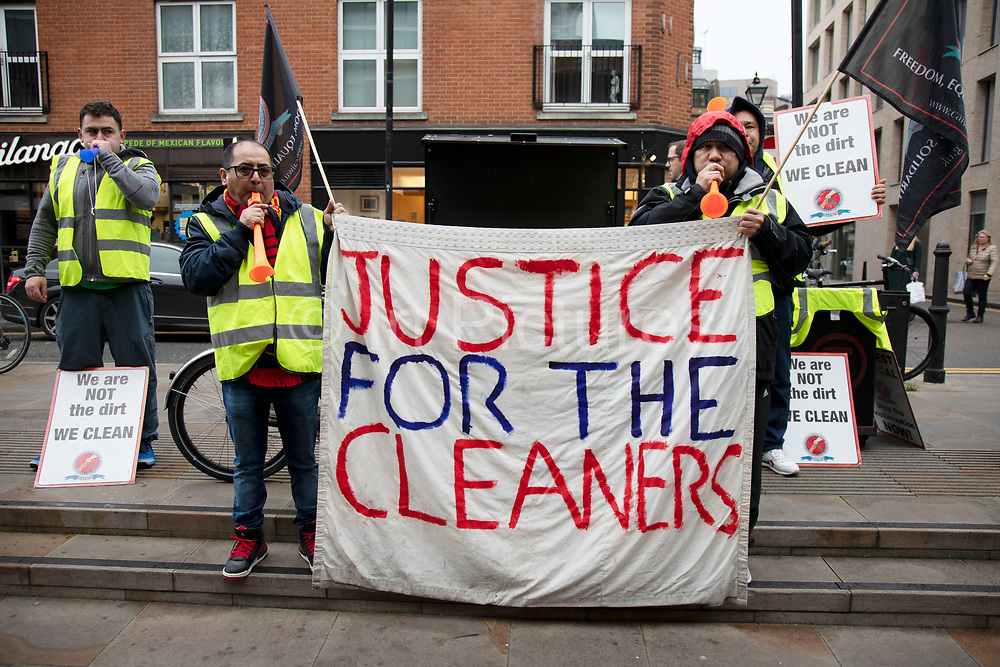 Cleaners demonstrate for a living wage as staff of Patisserie Valerie in Spitalfields on 8th December 2018 in London, United Kingdom. These cleaning workers were also protesting at the conditions within which they were working under.
