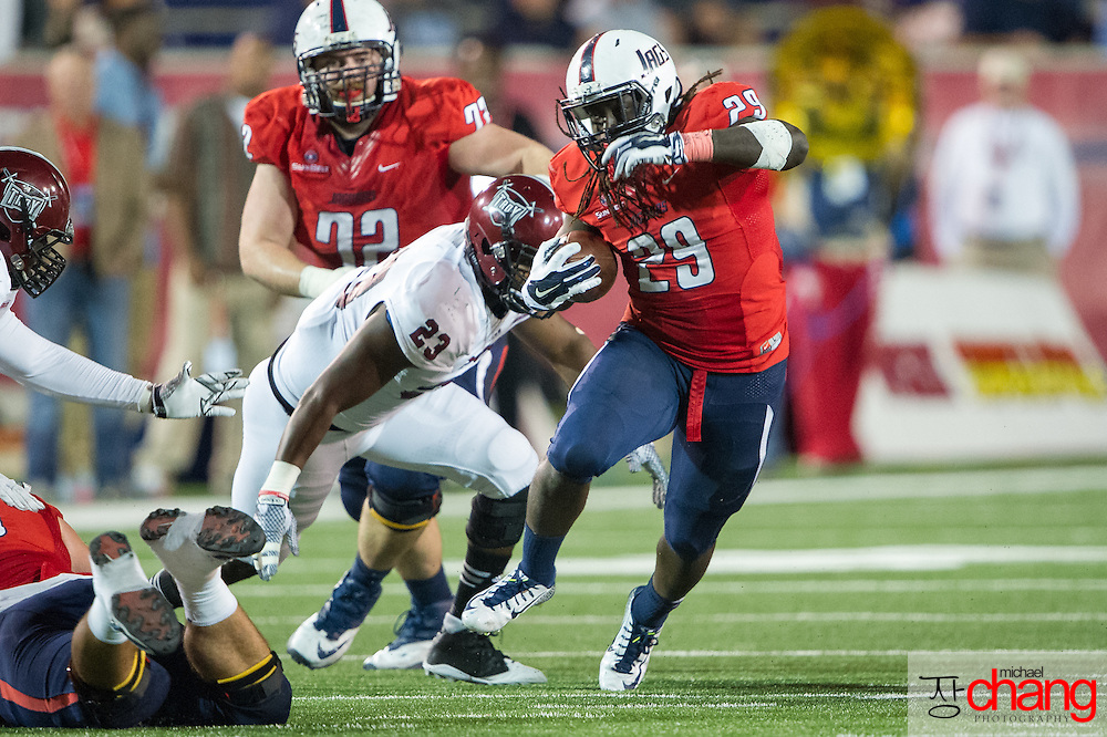 MOBILE, AL - OCTOBER 24: Running back Kendall Houston #29 of the South Alabama Jaguars looks to maneuver by linebacker Wayland Coleman-Dancer #23 of the Troy Trojans on October 24, 2014 at Ladd-Peebles Stadium in Mobile, Alabama.  The South Alabama Jaguars defeated the Troy Trojans 27-13. (Photo by Michael Chang/Getty Images) *** Local Caption *** Kendall Houston; Wayland Coleman-Dancer