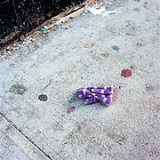 Stripped Purple Mitten (Child's Right), West 104th Street and Broadway. 1-March, 2003 / 4:30 PM
