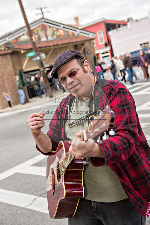Glenn Orange plays guitar on the streets outside of the Historic Charleston City Market on Market Street in Charleston, SC.