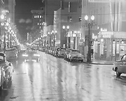 Y-540326A-3. SW Morrison looking east at the corner of 10th. March 26, 1954.