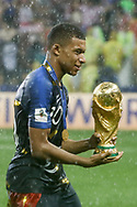 Kylian Mbappe of France celebrates with the trophy after winning the 2018 FIFA World Cup Russia, final football match between France and Croatia on July 15, 2018 at Luzhniki Stadium in Moscow, Russia - Photo Thiago Bernardes / FramePhoto / ProSportsImages / DPPI