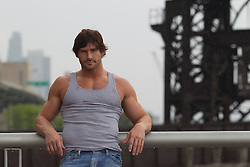 rugged good looking man wearing a tank top in New York City