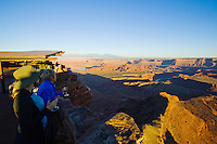 Tourists enjoy the changing colors and shadows at sunset, Dead Horse Point State Park, Utah