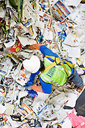 12 MARCH 2007 -- PHOENIX, AZ: GIOVANY ESPINOZA LOPEZ works in a pile of recyclable paper products at the new recycling center in the city of Phoenix, AZ. The center opened in February 2007 and is the most modern recyclables processing center in the US. The center is operated by Hudson Baylor Corporation and processes about 1000 tonnes of recyclables a week.  Photo by Jack Kurtz/ZUMA Press