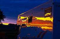 A camper at sunset, Cedar Pass campground, Badlands National Park, South Dakota USA