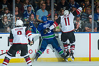KELOWNA, BC - SEPTEMBER 29:  Brendan Perlini #11 of the Arizona Coyotes checks Derrick Pouliot #5 of the Vancouver Canucks into the boards during first period at Prospera Place on September 29, 2018 in Kelowna, Canada. (Photo by Marissa Baecker/NHLI via Getty Images)  *** Local Caption *** Derrick Pouliot;Brendan Perlini