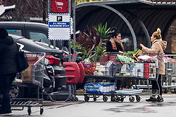 © Licensed to London News Pictures.05/01/2021, London, UK. Shoppers unpacking  full trolleys at Costco in Chingford, north London as the first day of the 3rd national Covid-19 lockdown started tonight. Photo credit: Marcin Nowak/LNP