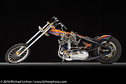 """""""Well Hung"""", a blue, black, and orange hung-motor digger built from a 1964 panhead by Dalton Walker of Split Image Kustoms in Hanford, CA. Photographed by Michael Lichter during the Easyriders Bike Show in Sacramento, CA on January 9, 2016. ©2016 Michael Lichter."""