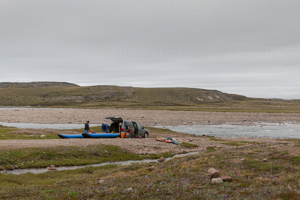 Preparing inflatable kayaks to put in on the Sylvia Grinnell River in Iqaluit, Nunavut. Photo © Robert Zaleski / rzcreative.com<br /> —<br /> To license this image for editorial or commercial use, please contact Robert@rzcreative.com