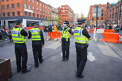 © Licensed to London News Pictures. 24/04/2021. Manchester, UK. Police officers patrolling Manchester city centre this evening.  Photo credit:  Ioannis Alexopoulos/LNP