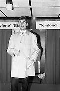 08/02/1966<br /> 02/08/1966<br /> 08 February 1966<br /> Fashion Show at I.C.I. Hawkins House. Frank searing a two piece suit  by Crescent and car coat by Junex.