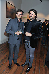 Left to right, JACK FREUD and STEFANO CATELLI at a private view of AMAZON an exhibition of photographs in aid of 'Sky Rainforest Rescue' held in the East Wing Galleries, Somerset House, London on 1st November 2011.