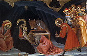 Adorationof the  Magi'  painting on panel. Taddeo di Bartolo (c1362-1422) Italian painter of the Sienese school. The three kings bring the symbolic gifts of Gold, Frankinsense and Myrhh to the Christ child in the stable. Ox and Ass in background.