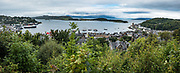Oban Bay and ferry terminal, seen from McCaig's Tower viewpoint. Oban is an important tourism hub and Caledonian MacBrayne (Calmac) ferry port, protected by the island of Kerrera and Isle of Mull, in the Firth of Lorn, Scotland, United Kingdom, Europe. This image was stitched from several overlapping photos.