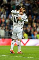Real Madrid´s Cristiano Ronaldo thank's James Rodriguez after 2014-15 La Liga match between Real Madrid and Malaga at Santiago Bernabeu stadium in Madrid, Spain. April 18, 2015. (ALTERPHOTOS/Luis Fernandez)